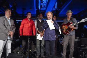 2014 SST Winners Perform at Montreux Jazz Festival 2014 in July: from left to right: Tony Antal Pusztai (SST Guitar Winner), Giorgi Mikadze (SST Piano Winner), Kenneth Salters (SST Drum Winner), Lee Ritenour, Andres Rotmistrovsky (SST 1st Runner Up Bass Winner), and Leandro Pellegrino (MJF Guitar Winner 2013).